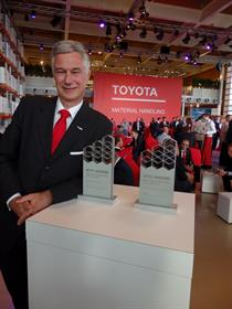 Matthias Fischer, CEO and president of TMHE, with Toyota's IFOY awards