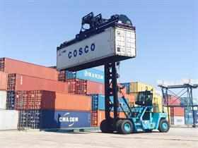 Hoist top pick on a loaded container handler
