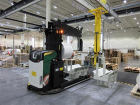 Rocla Probe-AGV placing rolls on a stand for later packaging of customer pallets.