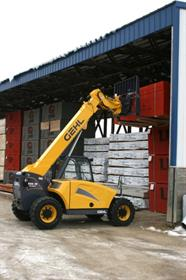 A Gehl telehandler moving materials in a warehouse.