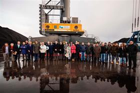 Company representatives and employees receive the new crane in Gijon, Spain