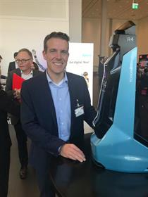 Toyota's Holger Urbschat with a model of the Ultralifter