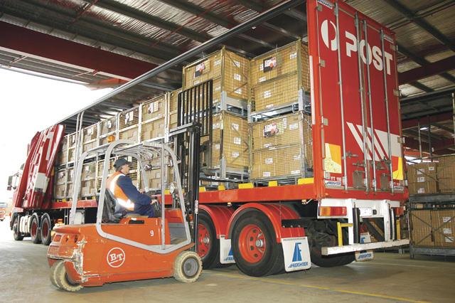 Forklift loading AusPost truck